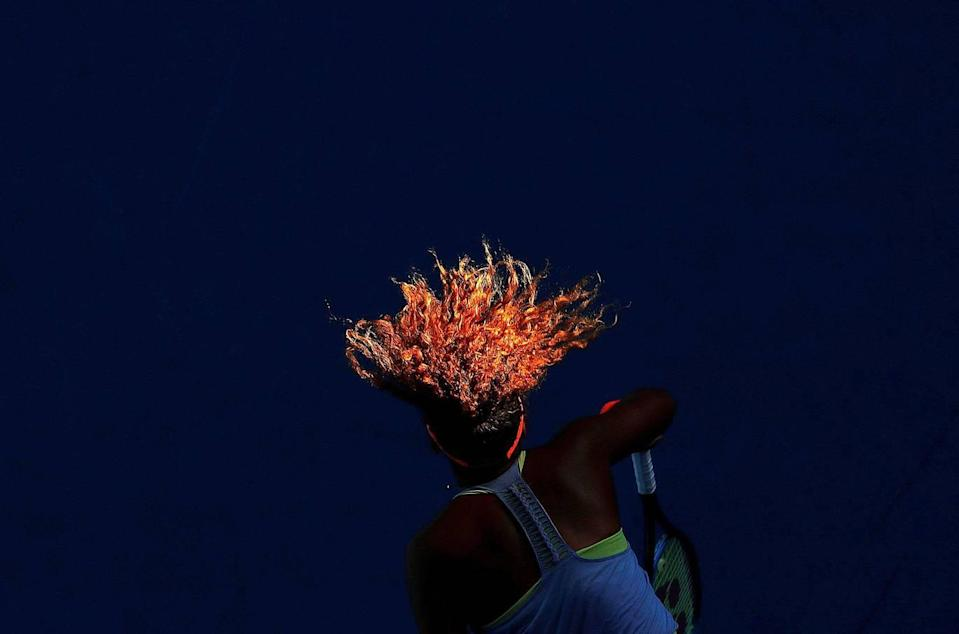<p>Naomi Osaka serves during her match against Simona Halep from Romania during the Australian Open tennis tournament, at Margaret Court Arena, Melbourne, Australia, on 22 January. (David Gray / Reuters) </p>