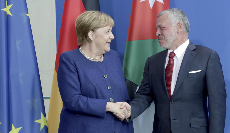 German Chancellor Angela Merkel, left, and Jordan's King Abdullah II, right, shake hands after a joint press conference as part of a meting at the Chancellery in Berlin, Germany, Tuesday, Sept. 17, 2019. (AP Photo/Michael Sohn)