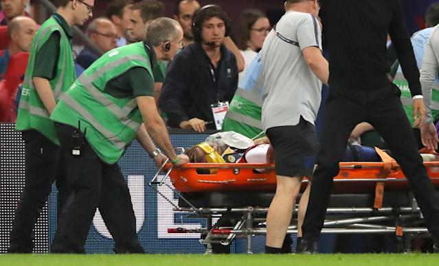 Shaw was attended by 10 medical staff before being wheeled off on a stretcher