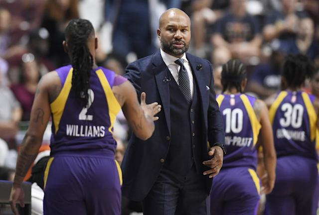 "Sparks coach Derek Fisher greets guard Riquna Williams as she exits the court during the first half of a WNBA playoff game against the Sun on Sept. 17, 2019, in Uncasville, Conn. <span class=""copyright"">(Jessica Hill / Associated Press)</span>"