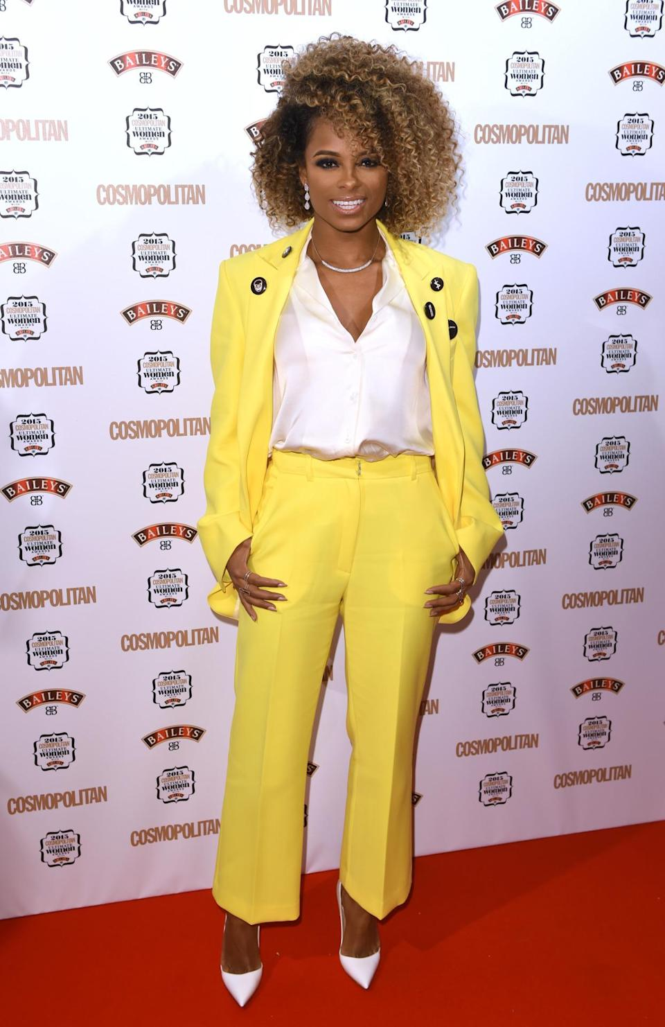 Singer Fleur East stood out from the crowd in a yellow tailored trouser suit. [Photo: Rex]