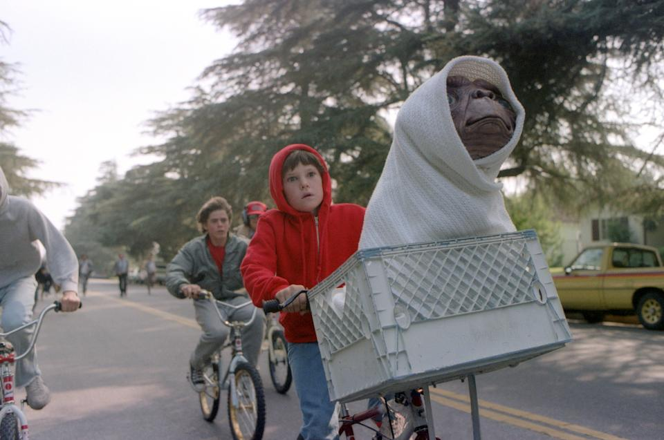 """Henry Thomas on the set of """"E.T."""". (Photo by Sunset Boulevard/Corbis via Getty Images)"""