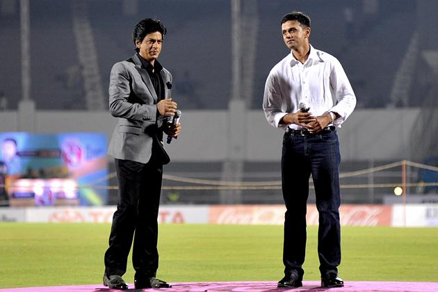 Indian Bollywood actor Shah Rukh Khan (L) and former Indian cricketer Rahul Dravid attend the grand opening ceremony of the Toyota University Cricket Championship (TUCC) first match of the season in Mumbai on February 23, 2013.  AFP PHOTO        (Photo credit should read STR/AFP/Getty Images)