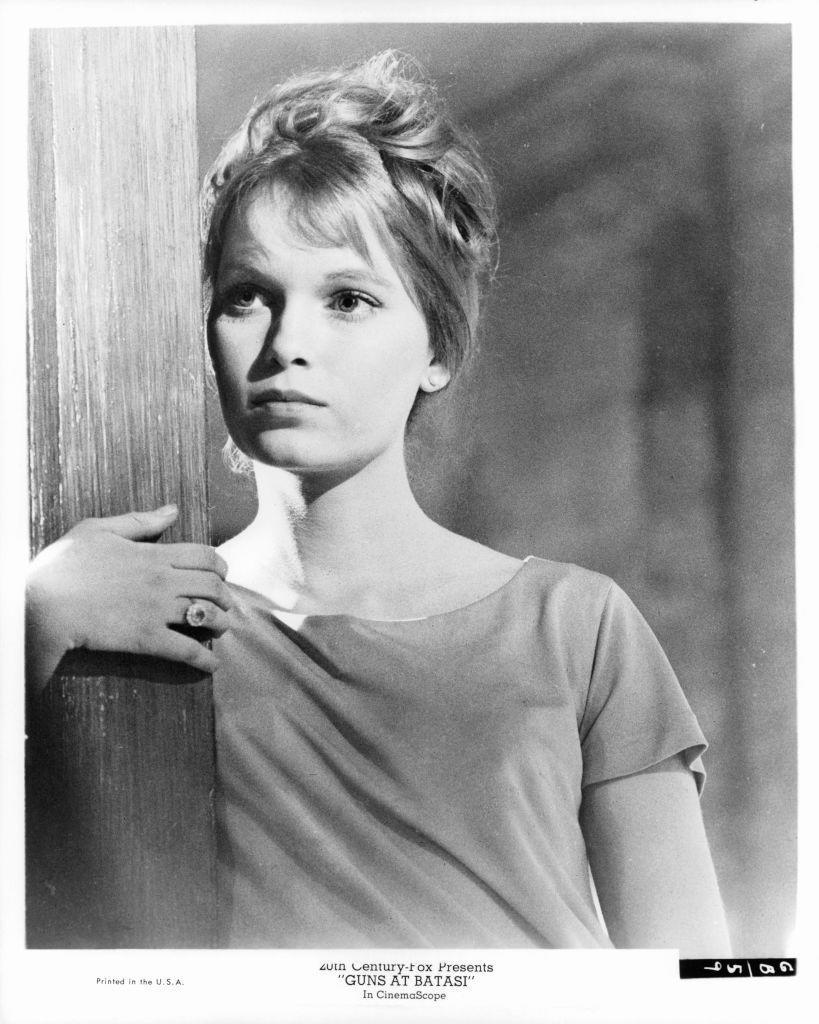 """<p>Farrow portrayed Karen Eriksson in <em>Guns at Batsai. </em>While British actress <a href=""""https://www.imdb.com/title/tt0058166/trivia"""" rel=""""nofollow noopener"""" target=""""_blank"""" data-ylk=""""slk:Britt Ekland originally signed on"""" class=""""link rapid-noclick-resp"""">Britt Ekland originally signed on</a> for the role of Eriksson, she backed out of production and Farrow was quickly chosen as her replacement. </p>"""