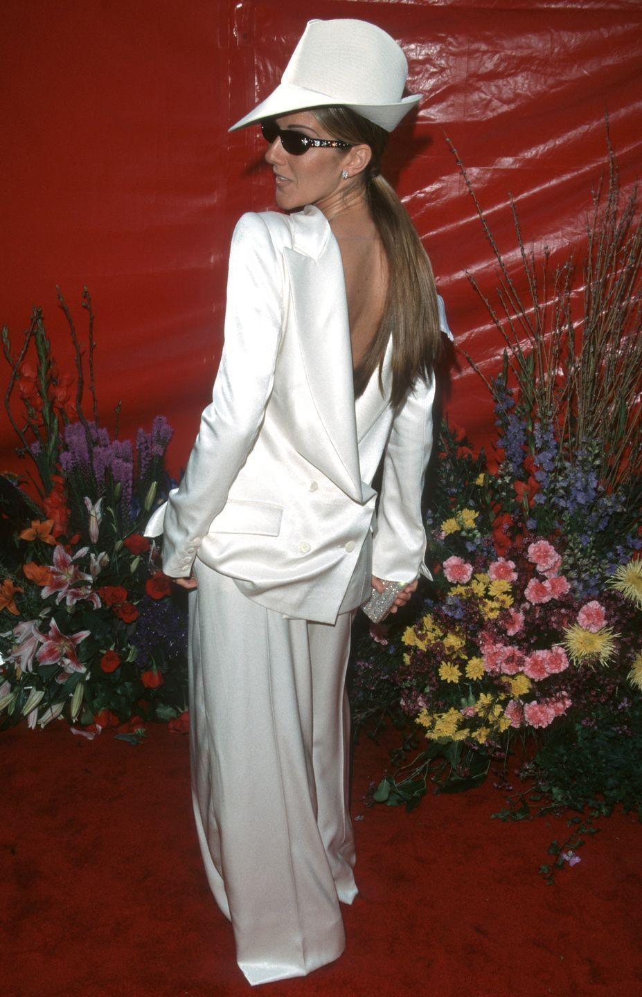 <p>One word: UNFORGETTABLE. Celine knew how to be the talk of the red carpet that year when she wore the blazer on her all-white Dior suit backwards, and accessorized with a pointed hat and sunglasses (note: the ceremony was held in the evening). She performed along side Andrea Bocelli at the ceremony. </p>