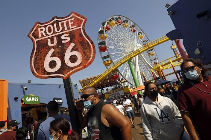 Santa Monica, CALIFORNIA—May 30, 2021--People flock to Santa Monica Pier and Santa Monica beach on Memorial Day, May 30, 2021. (Carolyn Cole / Los Angeles Times)