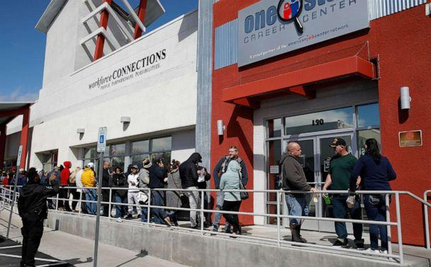 PHOTO: People wait in line for help with unemployment benefits at the One-Stop Career Center in Las Vegas, March 17, 2020. (John Locher/AP, FILE)