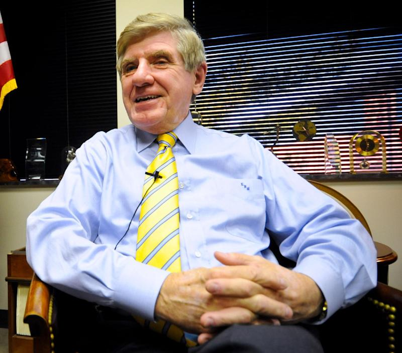 FILE -In this Dec. 28, 2011 file photo, then-Nebraska Sen. Ben Nelson, currently National Association of Insurance Commissioners CEO, smiles during an interview with The Associated Press in his Omaha, Neb office.  President Barack Obama's health care overhaul is unfolding as a national experiment with American consumers as the guinea pigs: Who will do a better job getting uninsured people covered, the states or the feds? (AP Photo/Dave Weaver, File)
