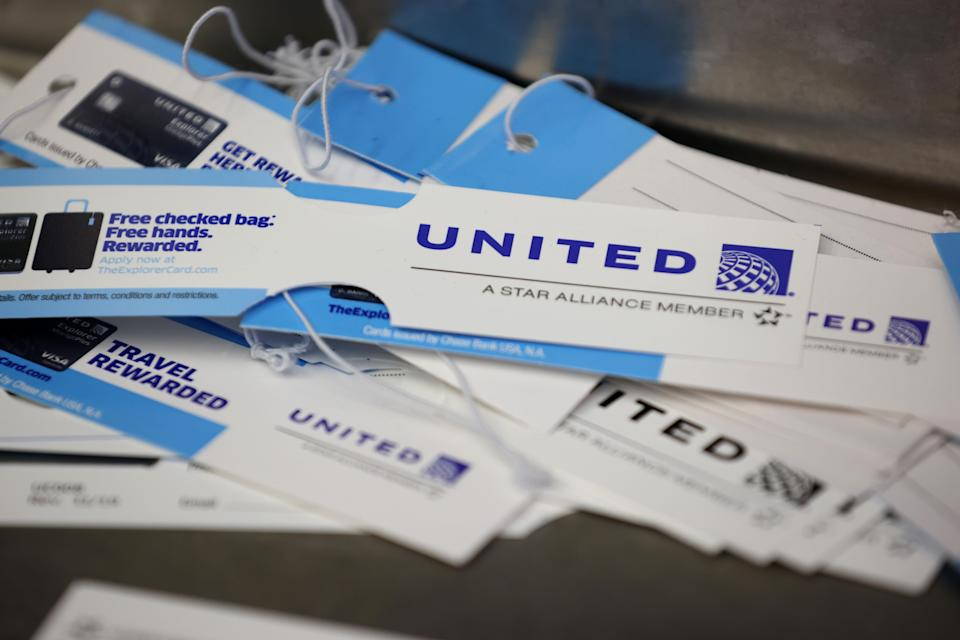 SAN FRANCISCO, CALIFORNIA - SEPTEMBER 02: United Airlines bag tags are displayed on a table at San Francisco International Airport on September 02, 2020 in San Francisco, California. As the coronavirus COVID-19 pandemic continues to hinder travel, United Airlines announced plans to furlough over 16,000 workers including pilots, flight attendants and technicians. (Photo by Justin Sullivan/Getty Images)