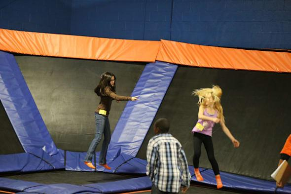 Girls And Boy Jumping On Trampoline