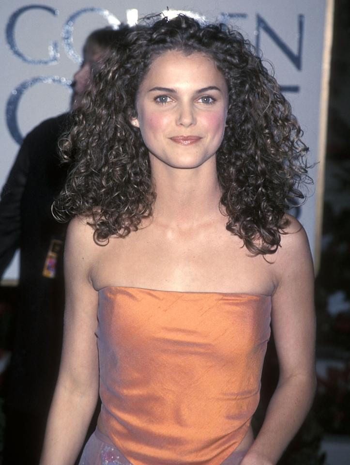 <p>Keeping her curls shoulder length with rosy cheeks and glossy mauve lip, Russell arrives at the 56th Annual Golden Globe Awards. (1999)</p>