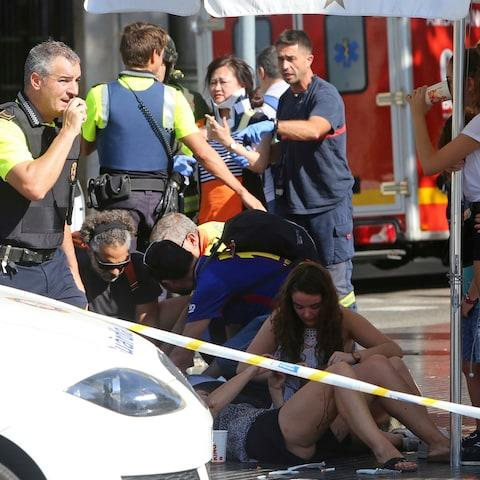 Injured people are treated in Barcelona, Spain