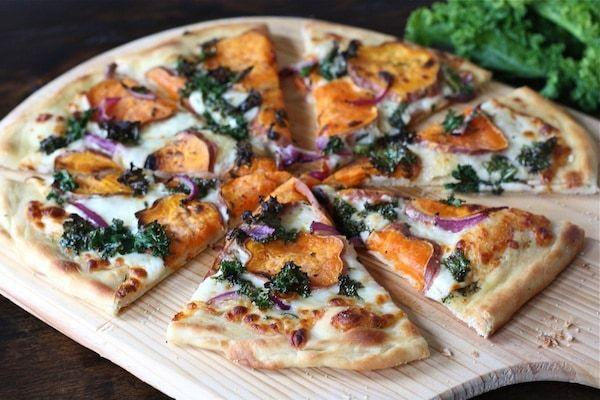 """<p>Who would say no to a side of pizza? This restaurant-worthy pie is dressed up with thinly sliced sweet potato, red onion, kale, and balsamic vinegar.</p><p><strong>Get the recipe at <a href=""""https://www.twopeasandtheirpod.com/sweet-potato-kale-pizza-with-rosemary-red-onion/"""" rel=""""nofollow noopener"""" target=""""_blank"""" data-ylk=""""slk:Two Peas & Their Pod"""" class=""""link rapid-noclick-resp"""">Two Peas & Their Pod</a>.</strong></p><p><a class=""""link rapid-noclick-resp"""" href=""""https://www.amazon.com/s?k=pizza+peel&ref=nb_sb_noss_2&tag=syn-yahoo-20&ascsubtag=%5Bartid%7C2164.g.36876289%5Bsrc%7Cyahoo-us"""" rel=""""nofollow noopener"""" target=""""_blank"""" data-ylk=""""slk:SHOP PIZZA PEELS"""">SHOP PIZZA PEELS</a></p>"""