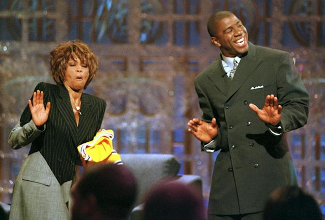 Magic Johnson and Whitney Houston dance during the taping of Magic Johnson's premier of his new television show, The Magic Hour, June 8 in Los Angeles. The Show will be aired on the Fox Television Network.