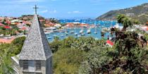 """<p><a rel=""""nofollow noopener"""" href=""""https://www.bestproducts.com/fun-things-to-do/g21237324/most-beautiful-islands-in-the-world/"""" target=""""_blank"""" data-ylk=""""slk:Saint-Barthélemy"""" class=""""link rapid-noclick-resp"""">Saint-Barthélemy</a>, or St. Bart's, in the French West Indies has long been an exclusive and decadent playground for the rich and famous, who tool around town on golf cart-like Mini Mokes (after mooring their mega yachts, of course). They come for beaches like <a rel=""""nofollow noopener"""" href=""""https://www.bestproducts.com/fun-things-to-do/g2750/top-nude-beaches-in-the-world/"""" target=""""_blank"""" data-ylk=""""slk:Grand Salines"""" class=""""link rapid-noclick-resp"""">Grand Salines</a> and to stroll in the capital Gustavia, filled with designer boutiques and chic cafes straight out of St. Tropez. </p>"""