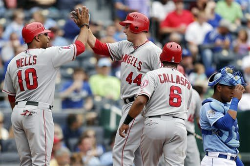 Los Angeles Angels' Mark Trumbo (44) celebrates with Vernon Wells (10) after hitting a three-run home run during the second inning of a baseball game against the Kansas City Royals, Sunday, Sept. 16, 2012, in Kansas City, Mo. (AP Photo/Charlie Riedel)