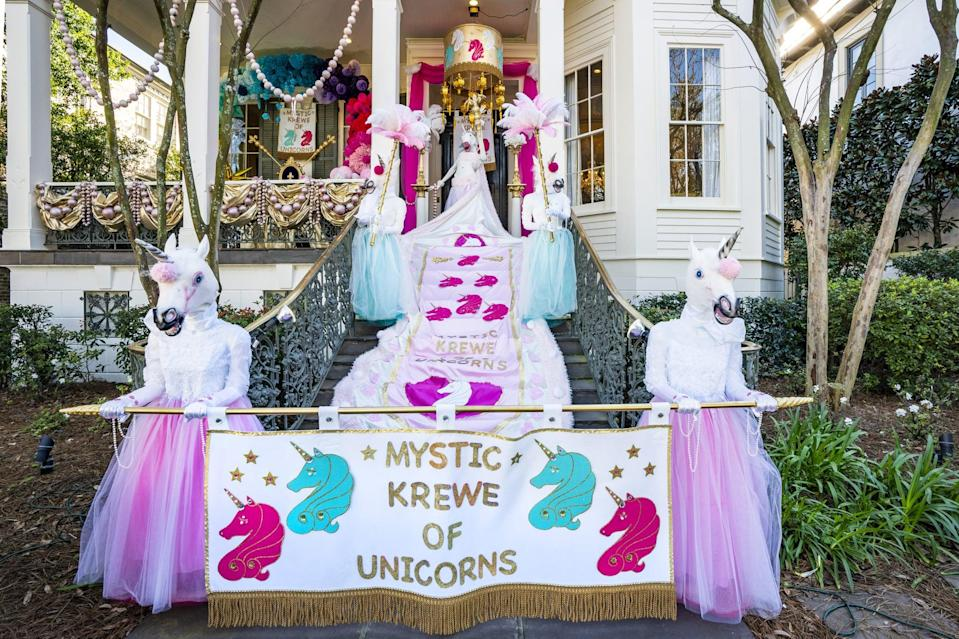 "<p>Labeled ""Mystic Krewe of Unicorns,"" this house opted for a non-traditional color sequence and pastel aesthetic. Life-size unicorn motifs line the staircase with bright, frilly textures.</p>"