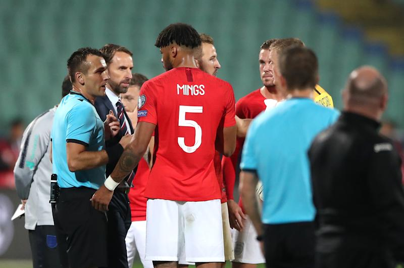 Match referee Ivan Bebek (left) speaks to England manager Gareth Southgate and Tyrone Mings with regards to racist chanting from fans during the UEFA Euro 2020 Qualifying match at the Vasil Levski National Stadium, Sofia, Bulgaria. (Photo by Nick Potts/PA Images via Getty Images)
