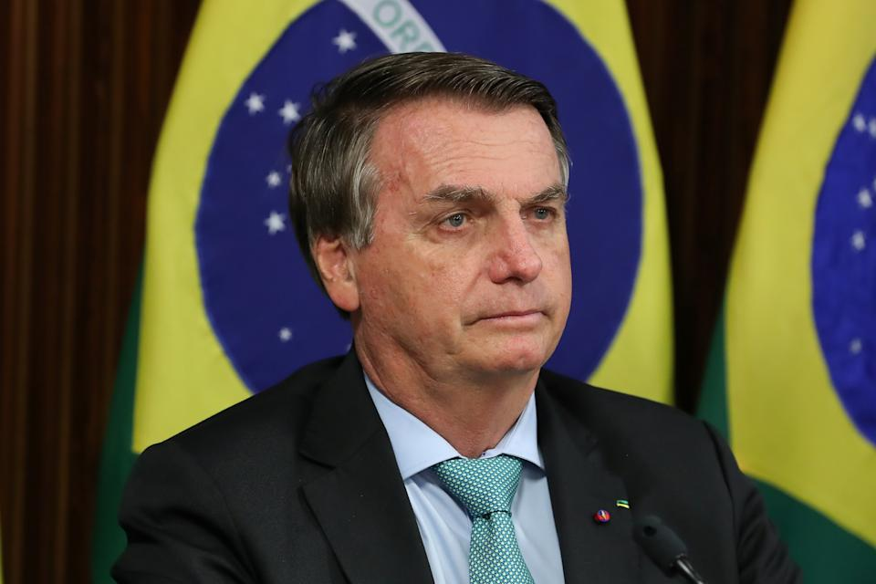 Brazil's President Jair Bolsonaro attends a virtual global climate summit via a video link in Brasilia, Brazil April 22, 2021. Marcos Correa/Brazilian Presidency via REUTERS THIS IMAGE HAS BEEN SUPPLIED BY A THIRD PARTY. MANDATORY CREDIT
