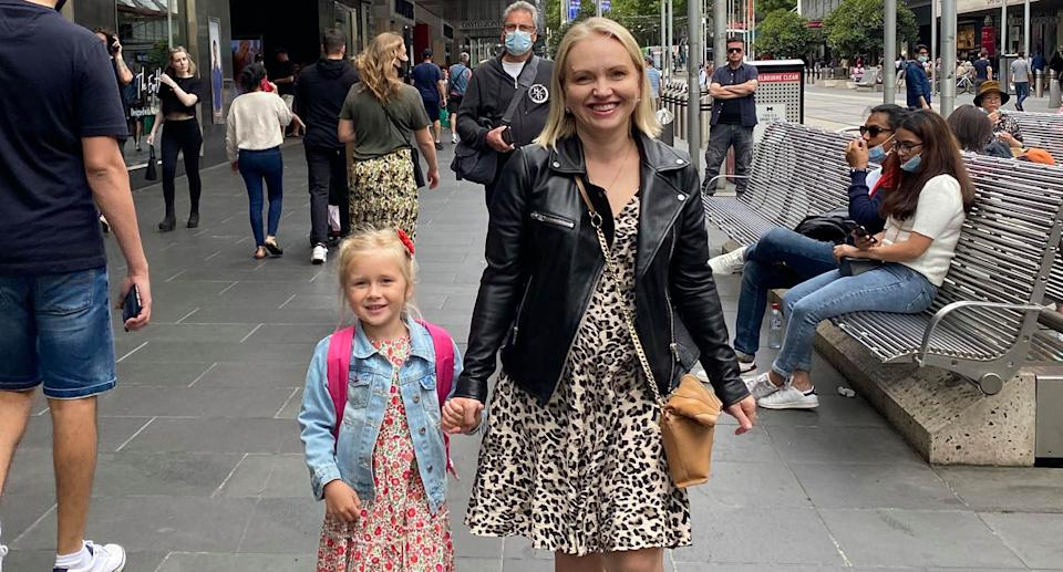 A photo of Olivia holding hands with her mother Yana. Source: Facebook