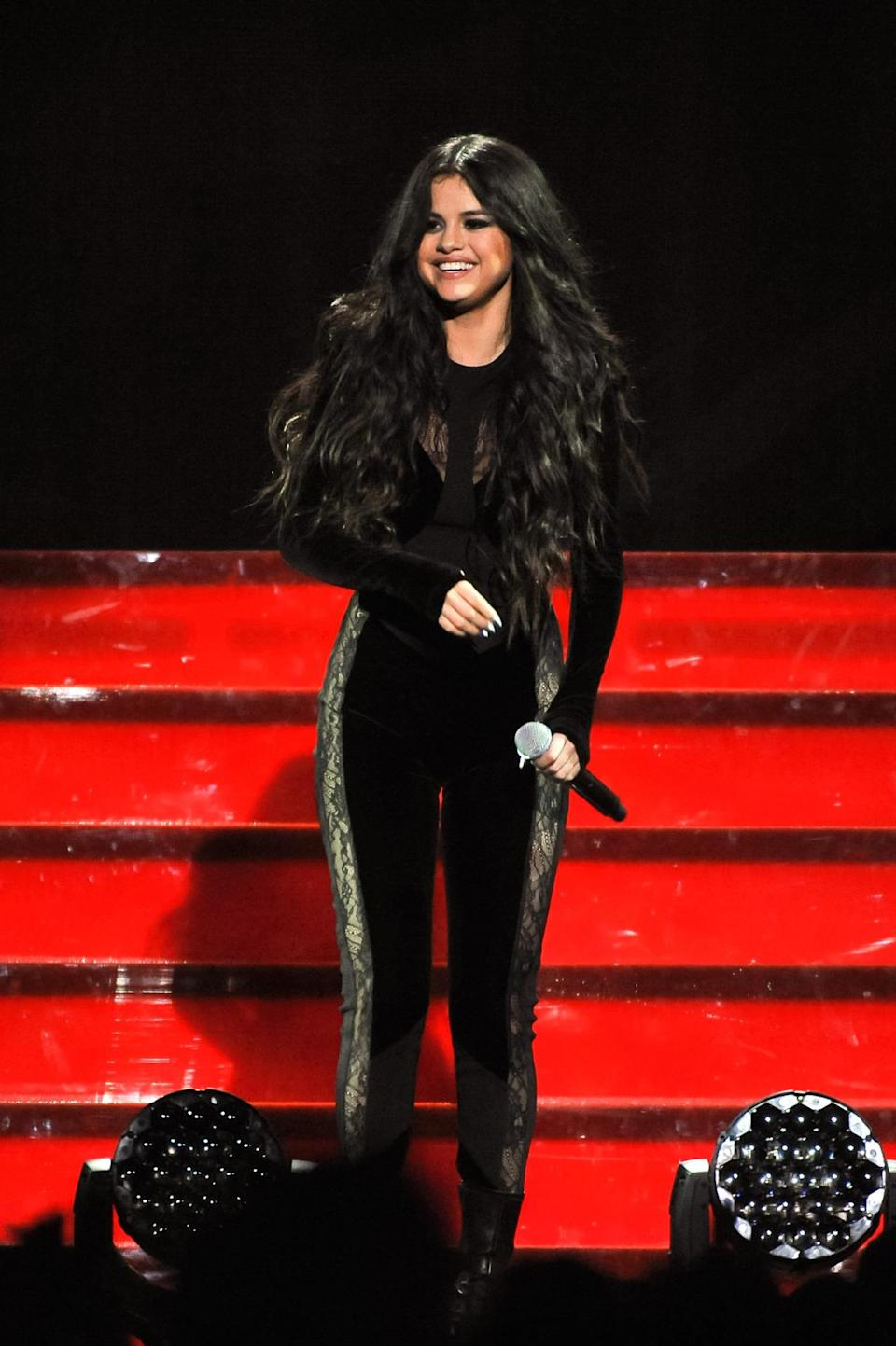 <p>Gomez went a bit more sultry for her performance outfit, in a black jumpsuit with lace detailing.</p>