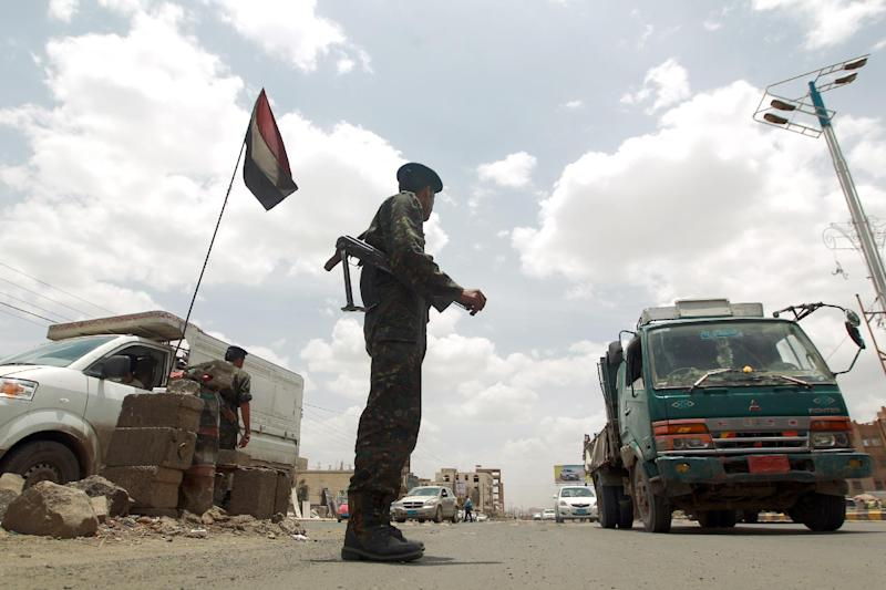 A Yemeni soldier mans a checkpoint in the capital Sanaa on May 12 , 2014. Authorities on January 17 detained two Frenchman accused of belonging to Al-Qaeda