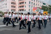 <p>Korean men march through the streets in uniform. Military parades are a common part of life in Pyongyang. (Getty) </p>