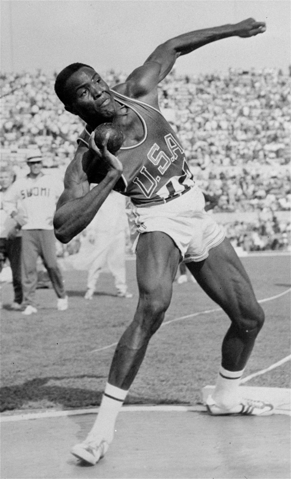 FILE - In this Sept. 5, 1960, file photo, Rafer Johnson of the United States competes in the shot put event of the Olympic decathlon competition in Rome, Italy. Rafer heaved the shot 51 feet 10 3/4 inches to score 976 points and lead the field in this event. Rafer Johnson, who won the decathlon at the 1960 Rome Olympics and helped subdue Robert F. Kennedy's assassin in 1968, died Wednesday, Dec. 2, 2020. He was 86. He died at his home in the Sherman Oaks section of Los Angeles, according to family friend Michael Roth.(AP Photo/FIle