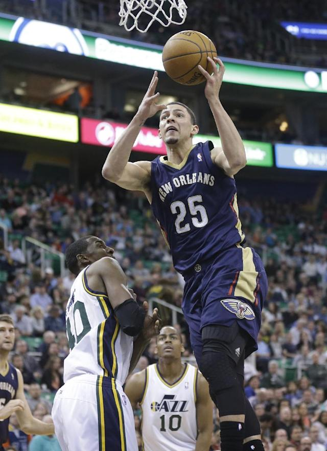 New Orleans Pelicans' Austin Rivers (25) goes to the basket as Utah Jazz's Jeremy Evans, left, and Alec Burks (10) defend in the second quarter during an NBA basketball game on Friday, April 4, 2014, in Salt Lake City. (AP Photo/Rick Bowmer)