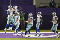 Dallas Cowboys tight end Dalton Schultz, left, celebrates with teammates after catching a 2-yard touchdown pass during the second half of an NFL football game against the Minnesota Vikings, Sunday, Nov. 22, 2020, in Minneapolis. (AP Photo/Jim Mone)