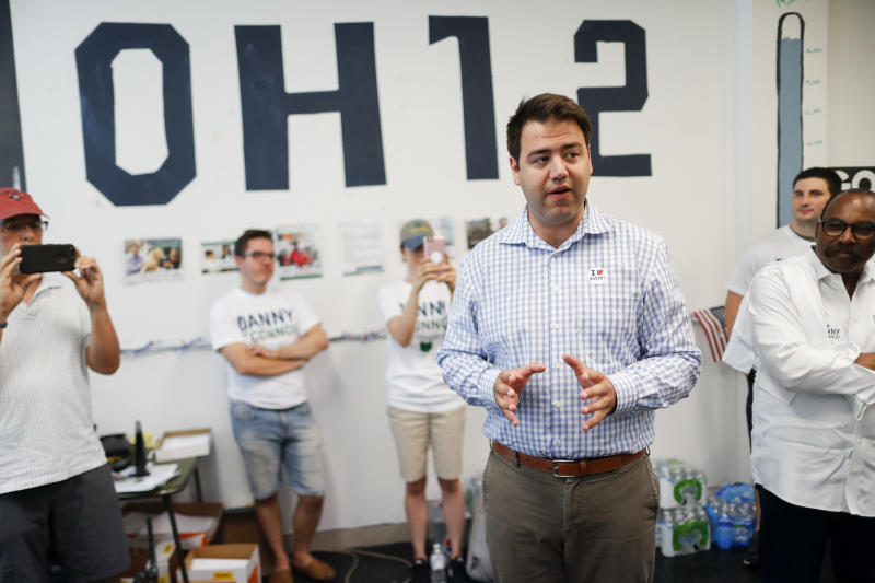 FILE – In this Aug. 7, 2018, file photo, Franklin County, Ohio, Recorder Danny O'Connor, center, the Democratic candidate running to succeed former Republican U.S. Rep. Pat Tiberi in Ohio's 12th District, speaks to volunteers and supporters at his campaign headquarters in Columbus, Ohio. Two-term Republican Ohio state Sen. Troy Balderson was certified Friday, Aug. 24, 2018, as the winner of a previously deadlocked congressional special election, defeating O'Connor to fill the final months of Tiberi's unexpired term, but both will face off again in the Nov. 6, 2018, general election to win a full, two-year term. (AP Photo/John Minchillo, File)