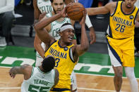 Indiana Pacers center Myles Turner (33) goes to the hoop against Boston Celtics guard Jeff Teague (55) in the first quarter of an NBA basketball game, Friday, Feb. 26, 2021, in Boston. (AP Photo/Elise Amendola)