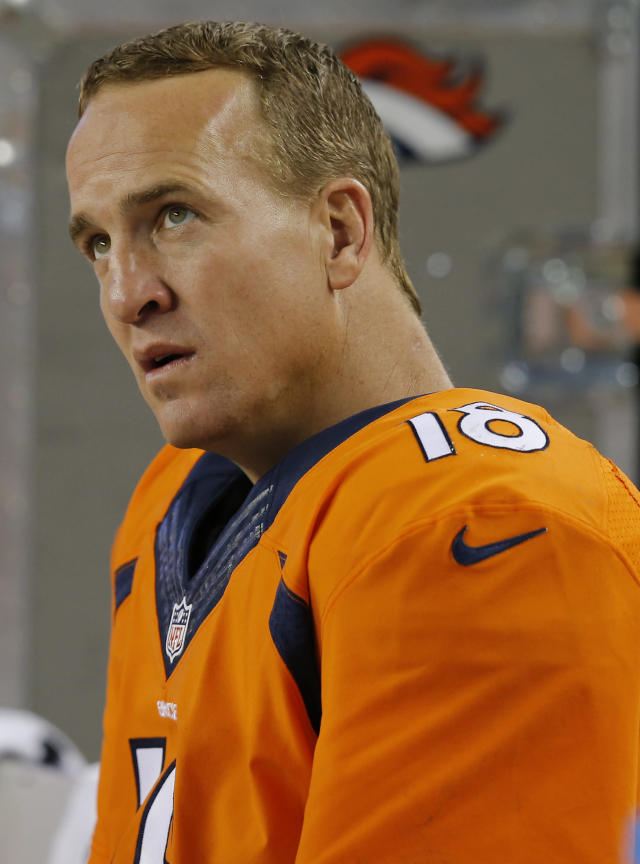 Denver Broncos quarterback Peyton Manning (18) sits on the bench during the first half of an NFL preseason football game against the Seattle Seahawks, Thursday, Aug. 7, 2014, in Denver. (AP Photo/Jack Dempsey)