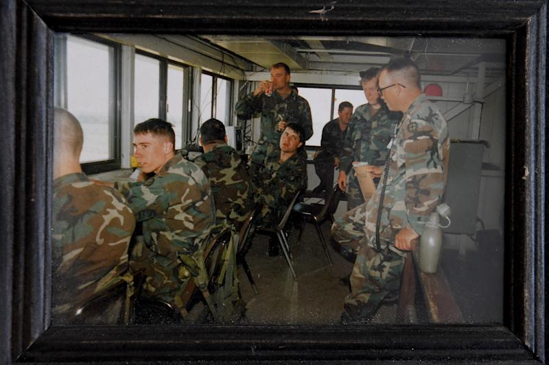 In this photo, Suzanne Wheeler (standing, with soda) is seen prior to her transition with the tank company she commanded. The photo, taken in July 1994, now sits on the desk in Wheeler's home office.