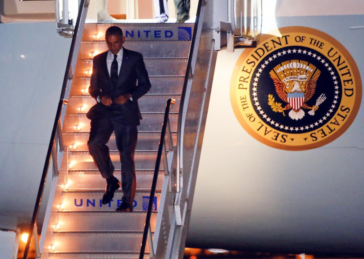 President Barack Obama walks down the stairs of Air Force One on arrival to Austin-Bergstrom International Airport on Wednesday, July 9, 2014, in Austin, Texas. Obama is spending the night in the Texas capital, and on Thursday, will make a speech on the economy. (AP Photo/Jack Plunkett)