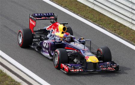 Red Bull Formula One driver Sebastian Vettel of Germany approaches the pit lane during the qualifying session for the Korean F1 Grand Prix at the Korea International Circuit in Yeongam, October 5, 2013. REUTERS/Lee Jae-Won