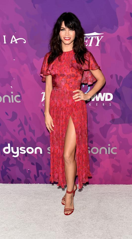 <p>The recipient of the style renegade award wore a red leaf print dress with a high slit. She completed the look with a bold rep lip color and heavy eye makeup. <em>(Photo: Getty Images)</em> </p>