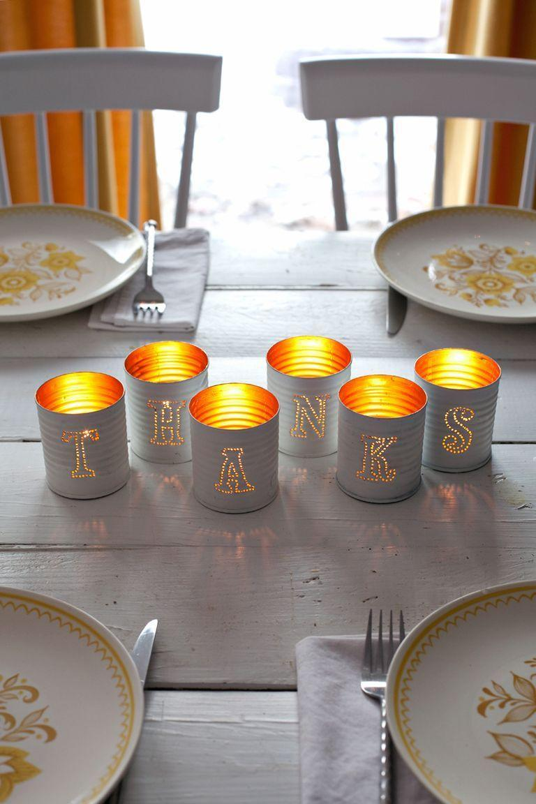 """<p>Add a sentimental touch to your table by opting for tin candle holders that spell out words like """"autumn"""" or """"thanks"""" for Thanksgiving.<br></p><p><em><a href=""""http://www.abeautifulmess.com/2014/11/tin-punched-votive-candles.html"""" rel=""""nofollow noopener"""" target=""""_blank"""" data-ylk=""""slk:Get the tutorial at a Beautiful Mess »"""" class=""""link rapid-noclick-resp"""">Get the tutorial at a Beautiful Mess »</a></em></p>"""