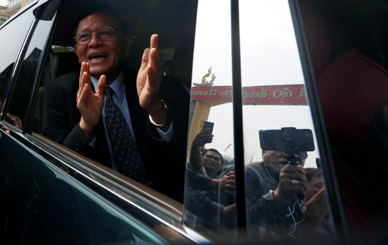 Cambodian opposition leader Kem Sokha gestures as he leaves the Municipal Court of Phnom Penh