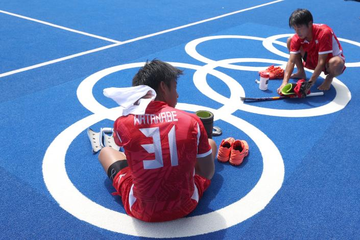<p>Kota Watanabe (L) and Kenta Tanaka of Team Japan cool down after a Team Japan Men's Hockey training session at Oi Hockey Stadium ahead of the Tokyo 2020 Olympic Games on July 23, 2021 in Tokyo, Japan. (Photo by Alexander Hassenstein/Getty Images)</p>