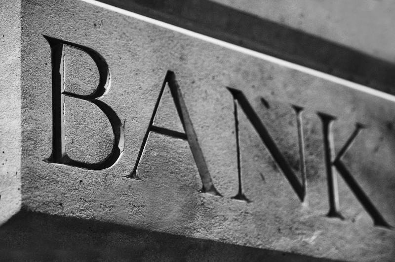 "Word ""bank"" carved into stone."