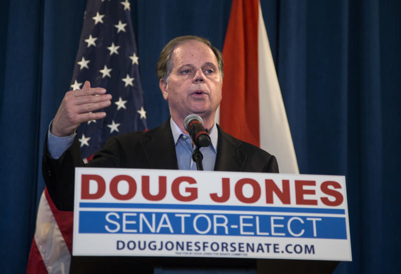 Senator-elect Doug Jones (D-Ala.) speaks to reporters on Dec. 13, 2017, the day after his upset victory in a special election for an open U.S. Senate seat. (Mark Wallheiser/Getty Images)
