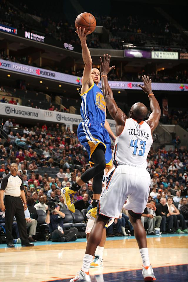 CHARLOTTE, NC - DECEMBER 9: Stephen Curry #30 of the Golden State Warriors shoots against the Charlotte Bobcats during the game at the Time Warner Cable Arena on December 9, 2013 in Charlotte, North Carolina. (Photo by Brock Williams-Smith/NBAE via Getty Images)