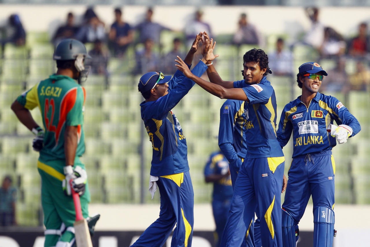 Sri Lanka's Suranga Lakmal, second right, celebrates with teammates the dismissal of Bangladesh's Nasir Hossain on the third one day international cricket in Dhaka, Bangladesh, Saturday, Feb. 22, 2014. (AP Photo/A.M. Ahad)
