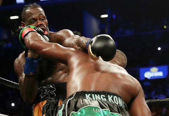 Luis Ortiz lands a blow on Deontay Wilder during their bruising first fight in 2018 (AFP Photo/AL BELLO)