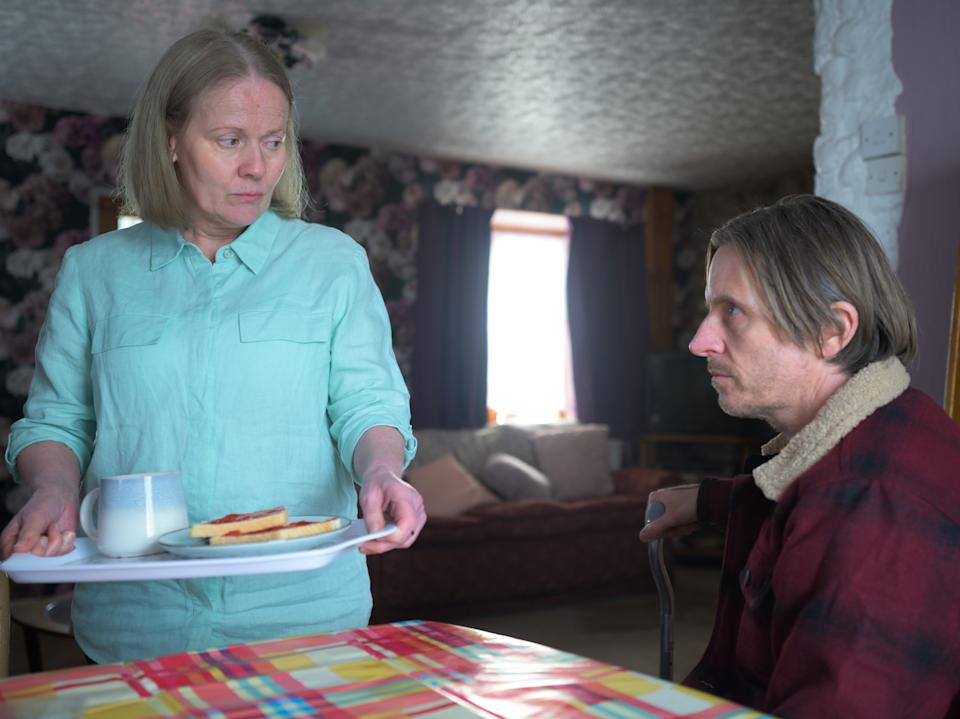 Pat Cooper (Caroline Berry) and her son Andrew (Oliver Ryan) in 'The Pembrokeshire Murders'ITV