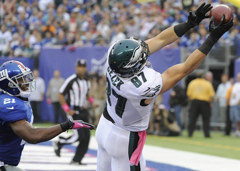Philadelphia Eagles tight end Brent Celek (87) catches a pass for a touchdown in front of New York Giants' Ryan Mundy (21) during the second half of an NFL football game on Sunday, Oct. 6, 2013, in East Rutherford, N.J. (AP Photo/Bill Kostroun)