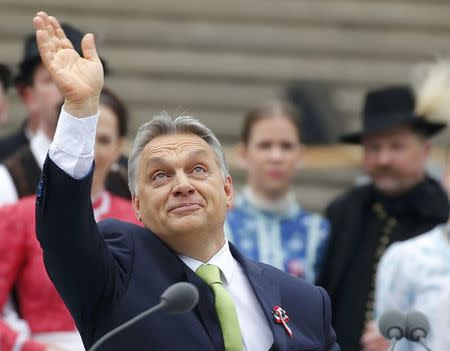 Hungarian Prime Minister Orban waves during Hungary's National Day celebrations in Budapest