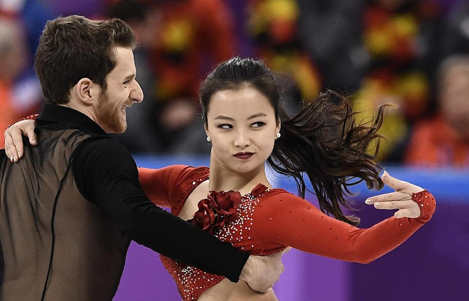 <p>South Korea's Yura Min and South Korea's Alexander Gamelin compete in the figure skating team event ice dance short dance during the Pyeongchang 2018 Winter Olympic Games at the Gangneung Ice Arena in Gangneung on February 11, 2018. / AFP PHOTO / ARIS MESSINIS </p>