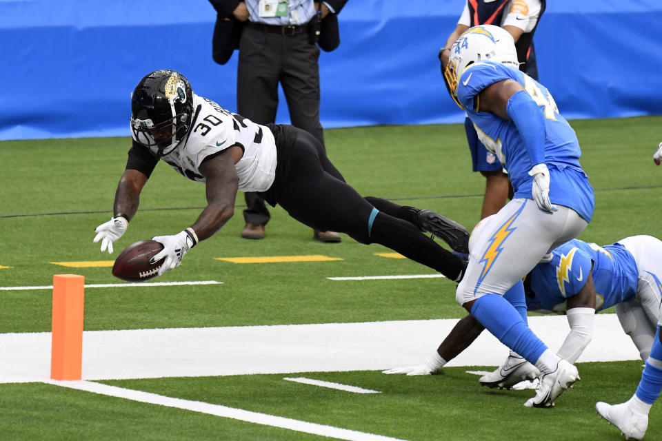 Jacksonville Jaguars running back James Robinson (30) lunges into the end zone for a touchdown during the first half of an NFL football game against the Los Angeles Chargers Sunday, Oct. 25, 2020, in Inglewood, Calif. (AP Photo/Kyusung Gong)